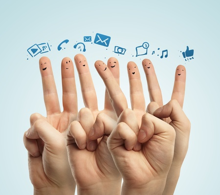 Happy group of finger smileys with social chat sign and speech bubbles,icons  Fingers representing a social network  Stock Photo - 13366206