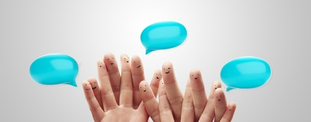 Happy group of finger smileys with social chat sign and speech bubbles,icons  Fingers representing a social network  photo