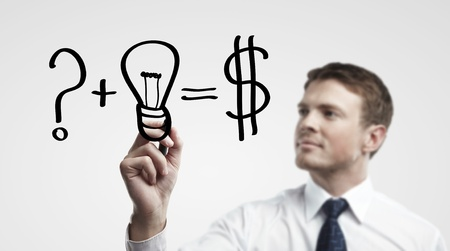 Young business man drawing a idea for making money photo