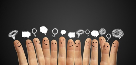 warmth: Happy group of finger smileys with social chat sign and speech bubbles,icons  Fingers representing a social network