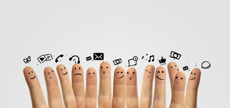 smiley icon: Happy group of finger smileys with social chat sign and speech bubbles,icons  Fingers representing a social network