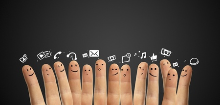 corporations: Happy group of finger smileys with social chat sign and speech bubbles,icons  Fingers representing a social network