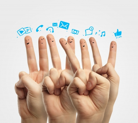 Happy group of finger smileys with social chat sign and speech bubbles,icons  Fingers representing a social network Stock Photo - 13366290