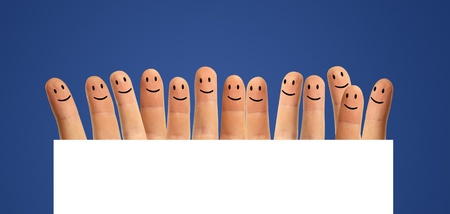 happy group of fingers and a blank field on a blue background photo