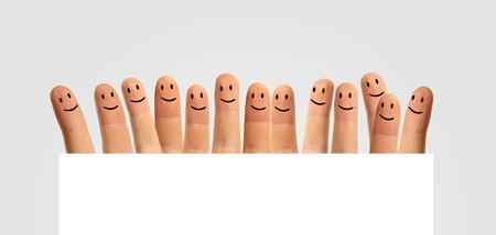 happy group of fingers and a blank field on a white background photo