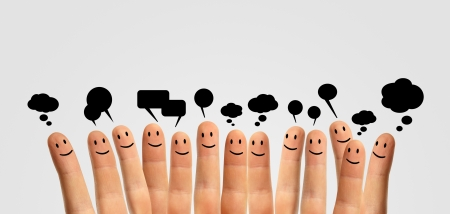 Happy group of finger smileys communicate with each other photo