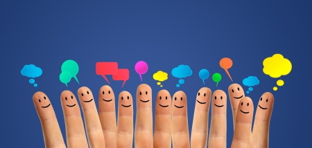 Happy group of finger smileys communicate with each other Stock Photo - 13999495