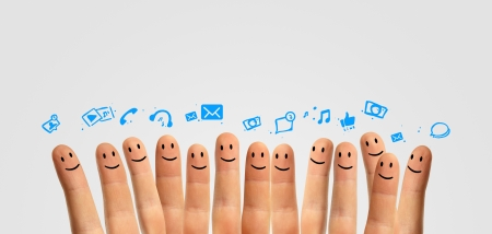 warmth: Happy group of finger smileys, concept of social network Stock Photo