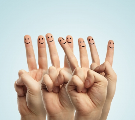 Happy group of finger smileys on a gray background photo