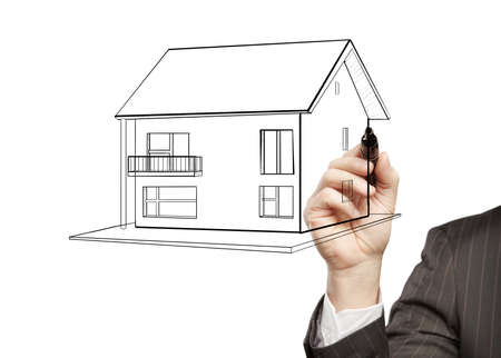 hand businessman draws a model house photo