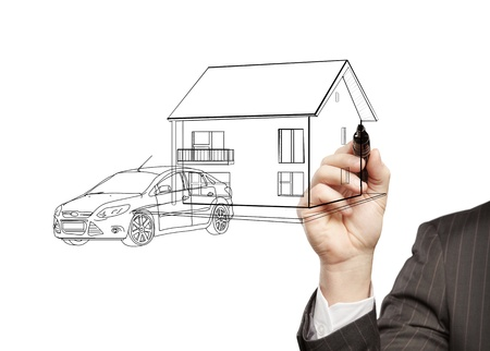 hand businessman draws a model house and car photo