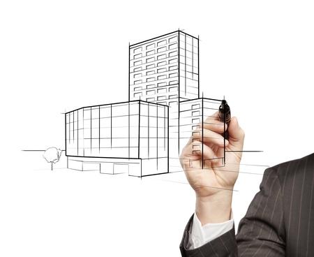 hand businessman draws a model building photo