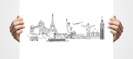drawing architectural buildings in female hands hands on a white  background photo