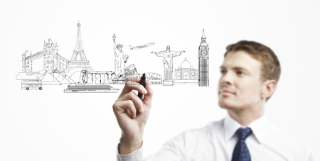businessman draws outline a architectural buildings photo