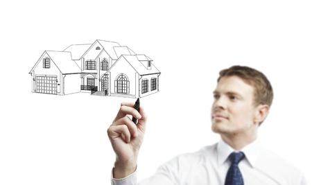 man marker draws a model house photo