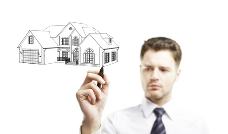 businessman marker draws a model house Stock Photo - 13999430