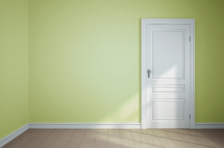 empty light green room with white door photo