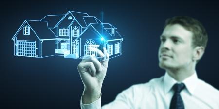 businessman draws cottage picture, concept  real estate photo