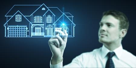 businessman draws cottage picture, concept  real estate Stock Photo - 14051959