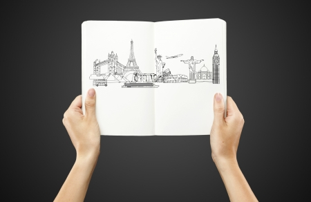 drawing architectural monuments in book on a black background photo