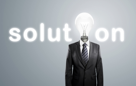 male costume: businessman with lamp-head, concept solution Stock Photo