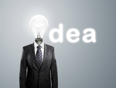 male costume: businessman with lamp-head, concept ideas Stock Photo