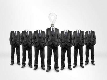 group of men with a lightbulb in  head photo