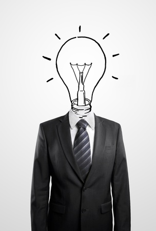 Businessman drawing a head lamp on a white background photo