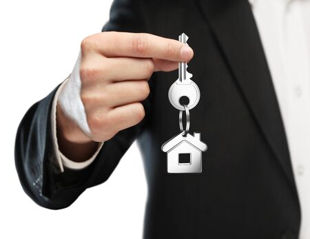 gives: businessman gives keys to house