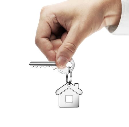 house key in hand on a white background Stock Photo - 14130182
