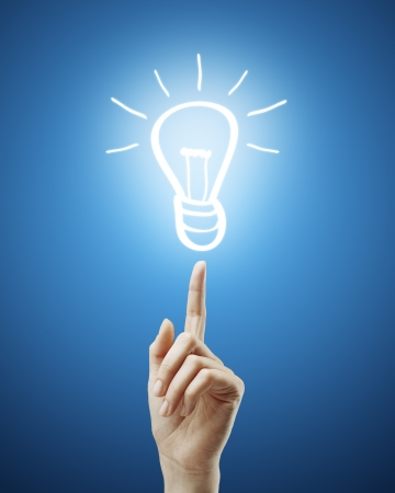 woman's hand points to drawing  light bulb Stock Photo - 14130176