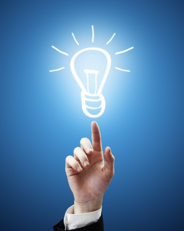 businessman hand points to drawing lamp Stock Photo - 14130175