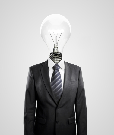male costume: businessman with lamp-head on a white background Stock Photo