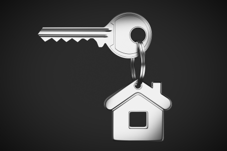 real estate investment: House shaped keychain and key Stock Photo