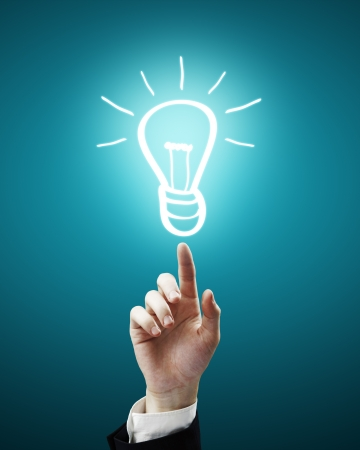 drawing lamp symbol on fingertip Stock Photo - 14107676