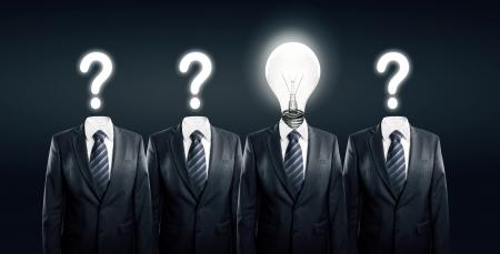 Businessman with idea standind between other businessmen Stock Photo - 14107691