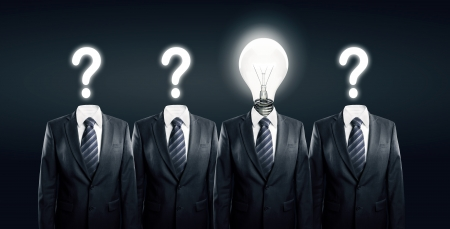 Businessman with idea standind between other businessmen Stock Photo - 14107691