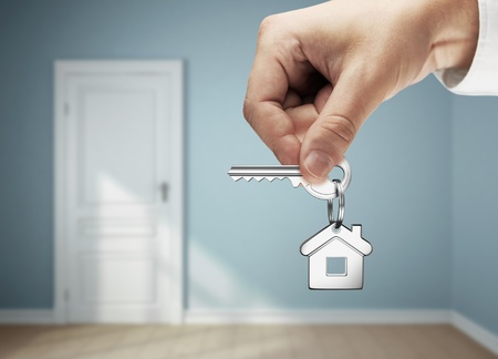 key in hand against the backdrop of the blue rooms Stock Photo - 14205882