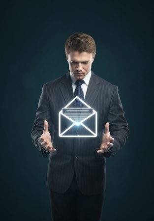 Businessman with a envelope on his hands photo