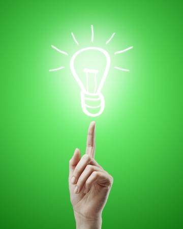 hand raised upwards indicates drawing  lamp Stock Photo - 14205991