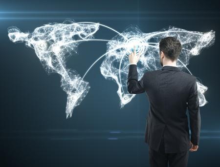 Businessman pressing a touchscreen Social Network button photo