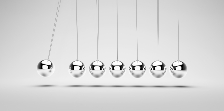 silver balls: Newtons cradle on a white background Stock Photo