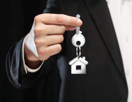 thumb keys: key chain with key in hand  businessman Stock Photo