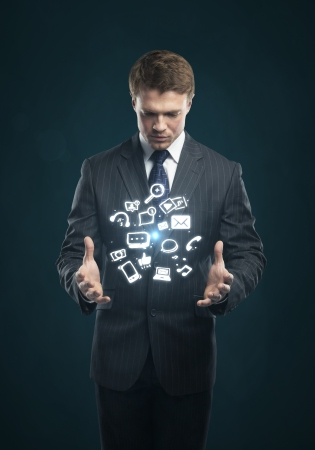 social issues: man with a social media icon on his hands Stock Photo