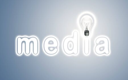 concept media and lamp on a blue background photo
