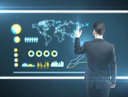 man pressing a touchscreen global communications button photo