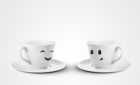 two happy cups on a white background photo