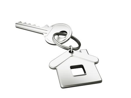 home key: Llave de casa aislada en el fondo blanco