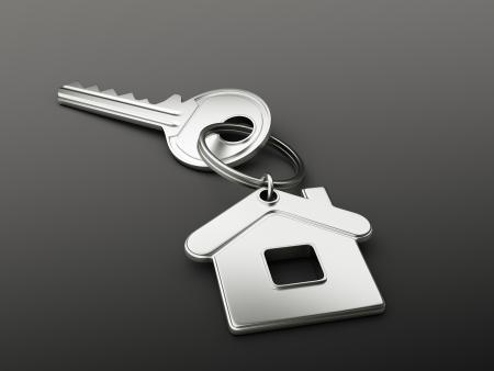 реальный: Дом ключ на черном фоне Фото со стока