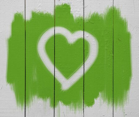 heart sign on painted wooden wall photo